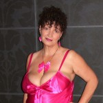 Mature wife Kim posing in sexy pink lingerie